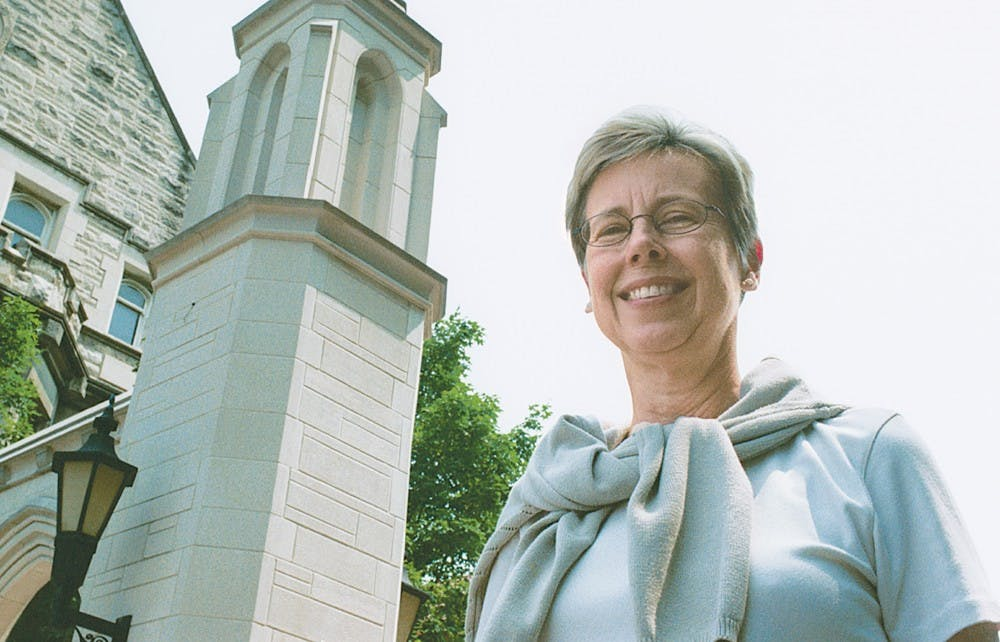 <p>IU Chancellor Sharon Brehm poses in front of the Sample Gates. Brehm died of complications from Alzheimer's disease. She is remembered for the energy and diligence she put toward the many positions she had during her time at IU.</p>