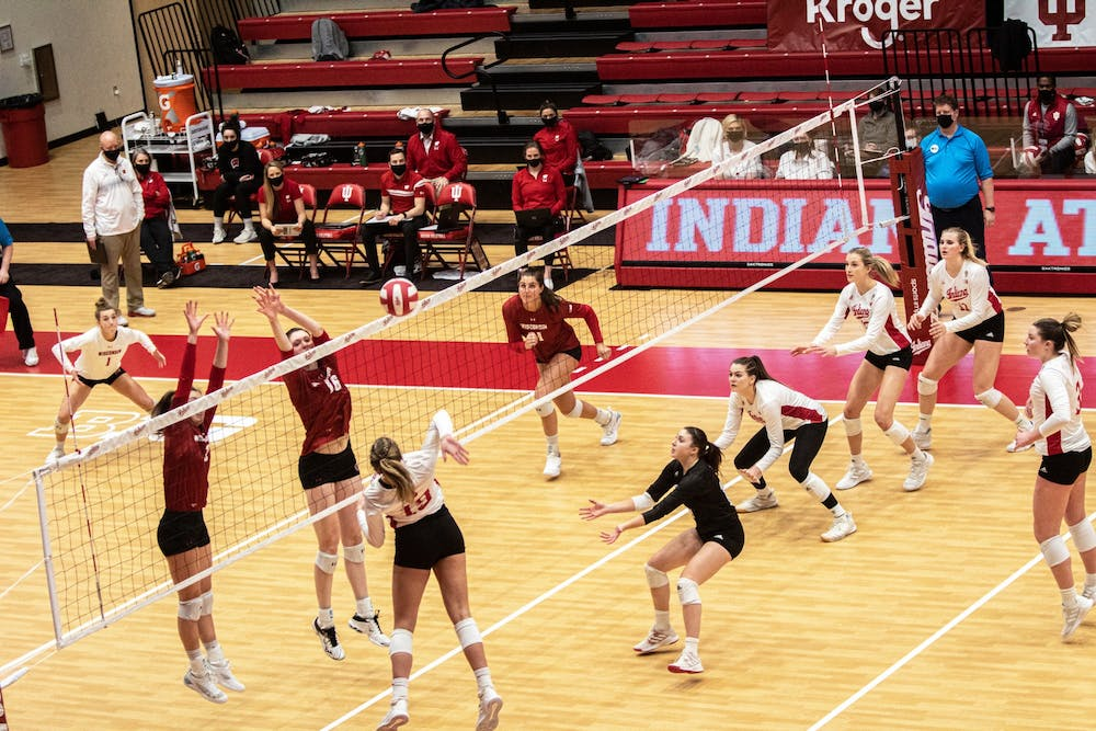 <p>Redshirt freshman outside hitter Ashley Zuluaf spikes the ball against Wisconsin on Feb. 13 in Wilkinson Hall. The IU volleyball team&#x27;s scheduled home matches against Ohio State this weekend have been canceled due to COVID-19 concerns within the Indiana program. </p>