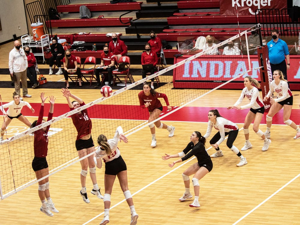 Redshirt freshman outside hitter Ashley Zuluaf spikes the ball against Wisconsin on Feb. 13 in Wilkinson Hall. The IU volleyball team's scheduled home matches against Ohio State this weekend have been canceled due to COVID-19 concerns within the Indiana program.