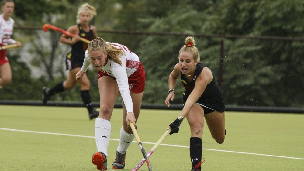 Now-junior forward Bente Buwalda fights for the ball against Maryland's Kyler Greenwalt on Oct. 12 at the IU Field Hockey Complex. The team picked up its first win of the season, 4-3, against Drexel University behind a double-overtime game-winner from senior forward Sheridan Weiss.