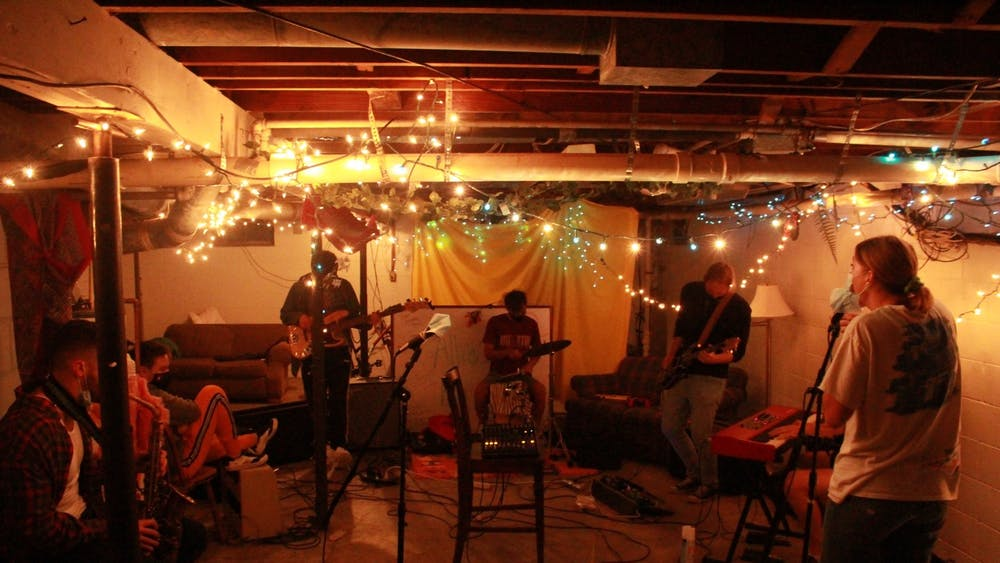 """Bloomington Delta Music Club rehearses its first single, a cover of """"Sour Candy"""" by the band Melt, in September, 2020, inside Bloomington DIY venue """"The Cabin."""" The group is an IU student run organization dedicated to giving local musicians who aren't involved in Jacobs or a full-time band an opportunity to continue playing despite not being involved in music at IU."""