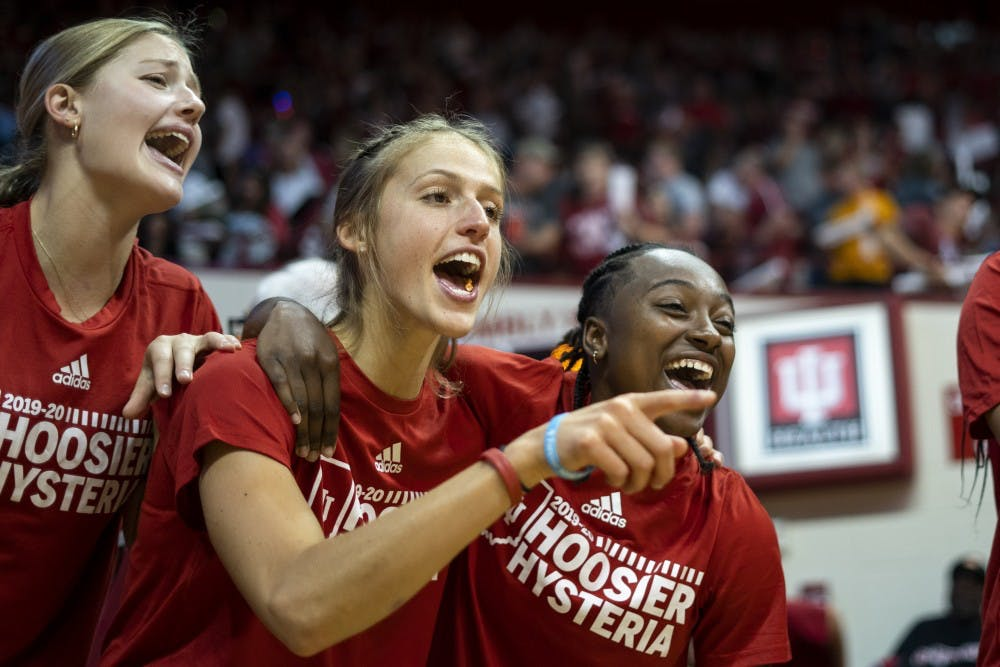 "<p>Women's basketball players sing along to ""Indiana, Our Indiana"" during Hoosier Hysteria on Oct. 5 in Simon Skjodt Assembly Hall. The team sang, danced and cheered on fellow teammates and the men's basketball team during the whole event.</p>"