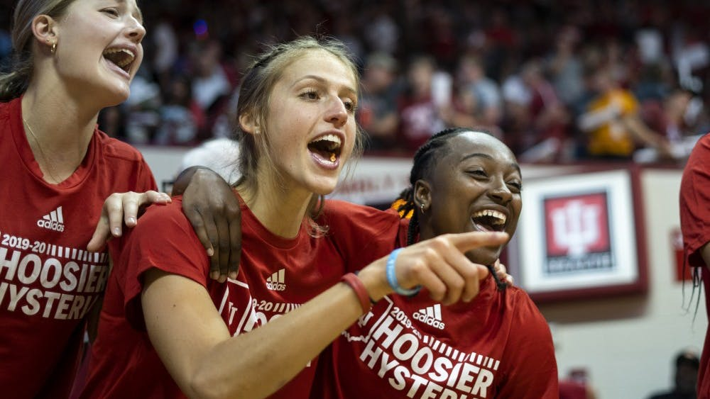 "Women's basketball players sing along to ""Indiana, Our Indiana"" during Hoosier Hysteria on Oct. 5 in Simon Skjodt Assembly Hall. The team sang, danced and cheered on fellow teammates and the men's basketball team during the whole event."