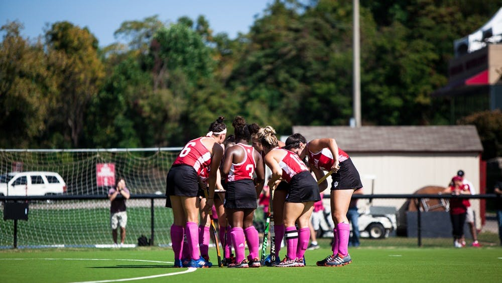 The IU field hockey team huddles before its match against Northwestern. The Hoosiers defeated the Wildcats 2-1.