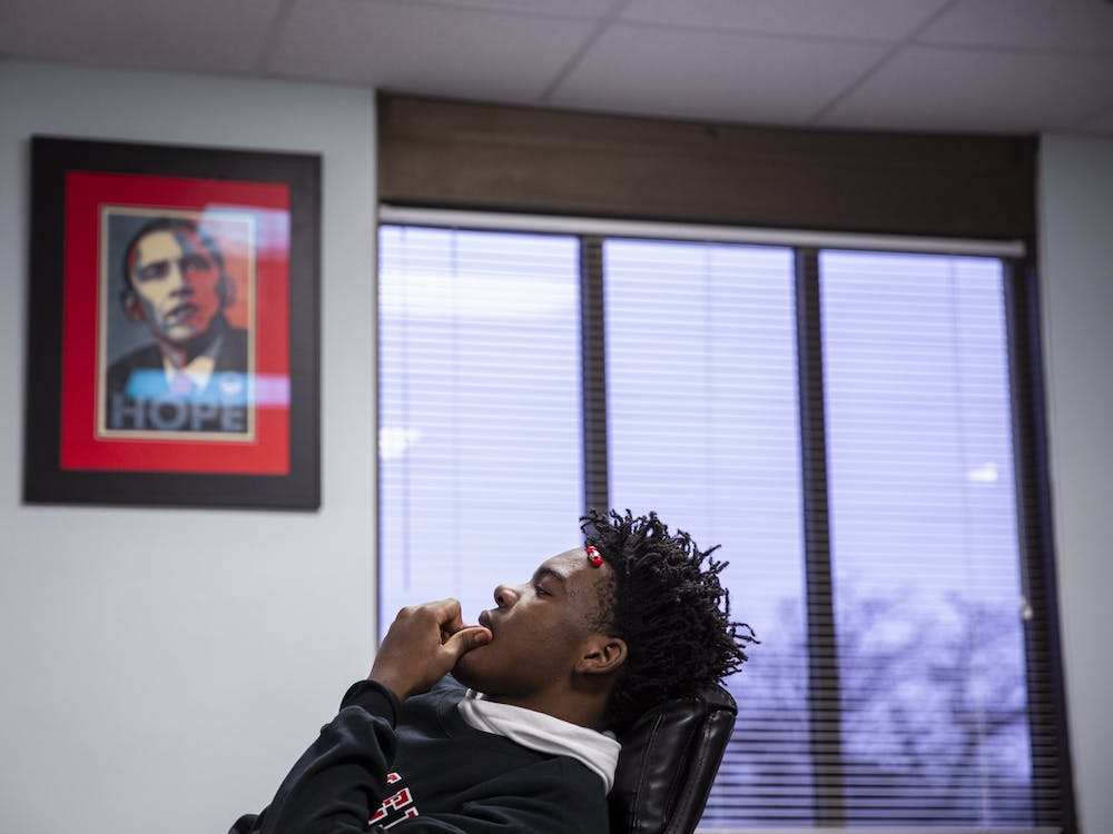 "Da'Quincy Pittman, 15, waits for his schedule Feb. 24, his first day back to school since being shot six times in December. ""It just hits me sometimes,"" he said. ""It haunts me."""