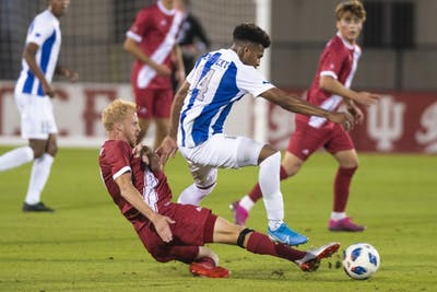 Senior Simon Waever slides to try and steal the ball from University of Kentucky sophomore Daniel Evans on Oct. 9 at Bill Armstrong Stadium. IU men's soccer lost to No. 25 Maryland on Friday night, its first Big Ten loss in four years.