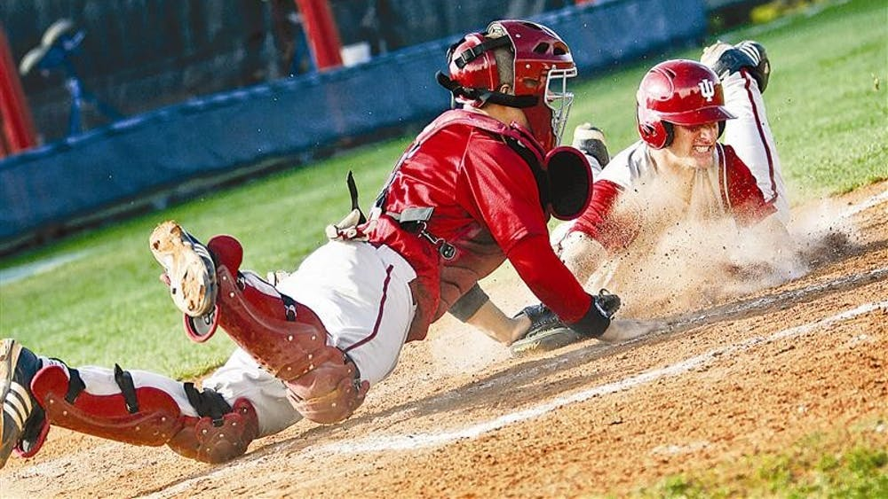 Sophomore catcher Wes Wilson makes an unsuccessful attempt at tagging freshman infielder Brian Ritz during game one of the Cream & Crimson World Series on Wednesday afternoon at Sembower Field. The Cream squad beat Crimson 6-2.