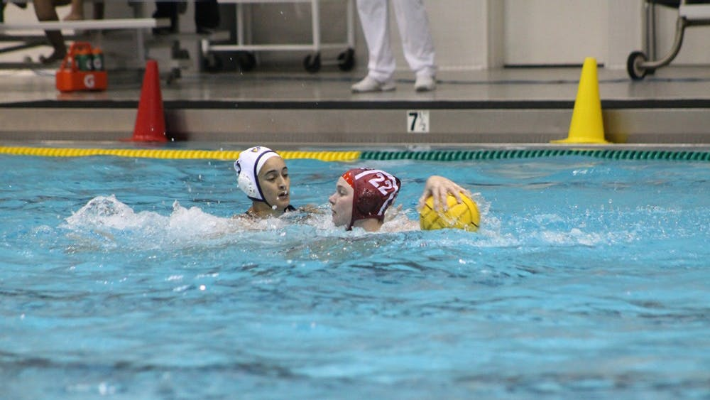 IU junior Sarah Young defends the ball from Califorina Baptist University during the first quarter of Saturday evening's match. Young scored five goals to help the Hoosiers defeat the Lancers 13-6.