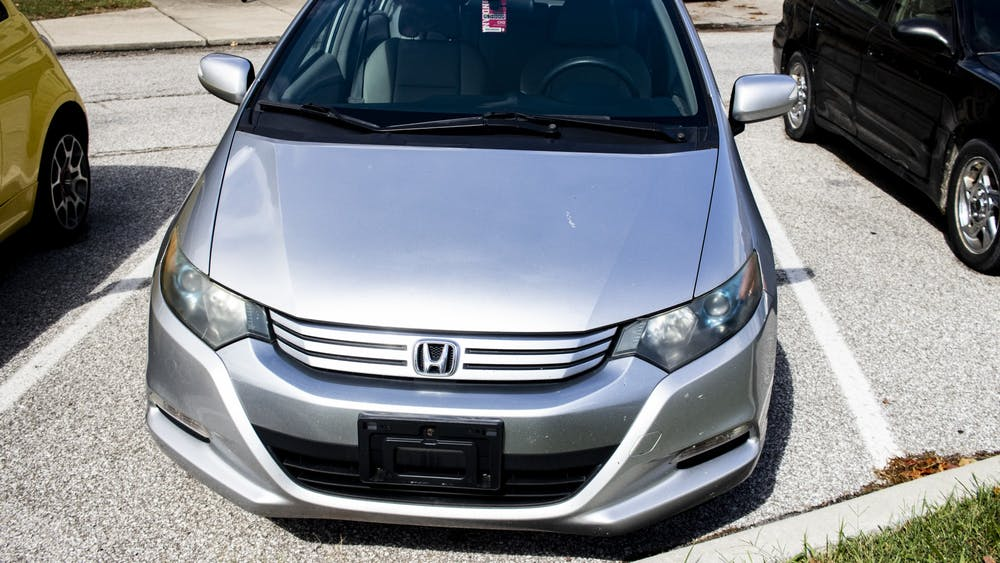 A Honda Insight sits in a parking lot Sept. 23 at University East Apartments.