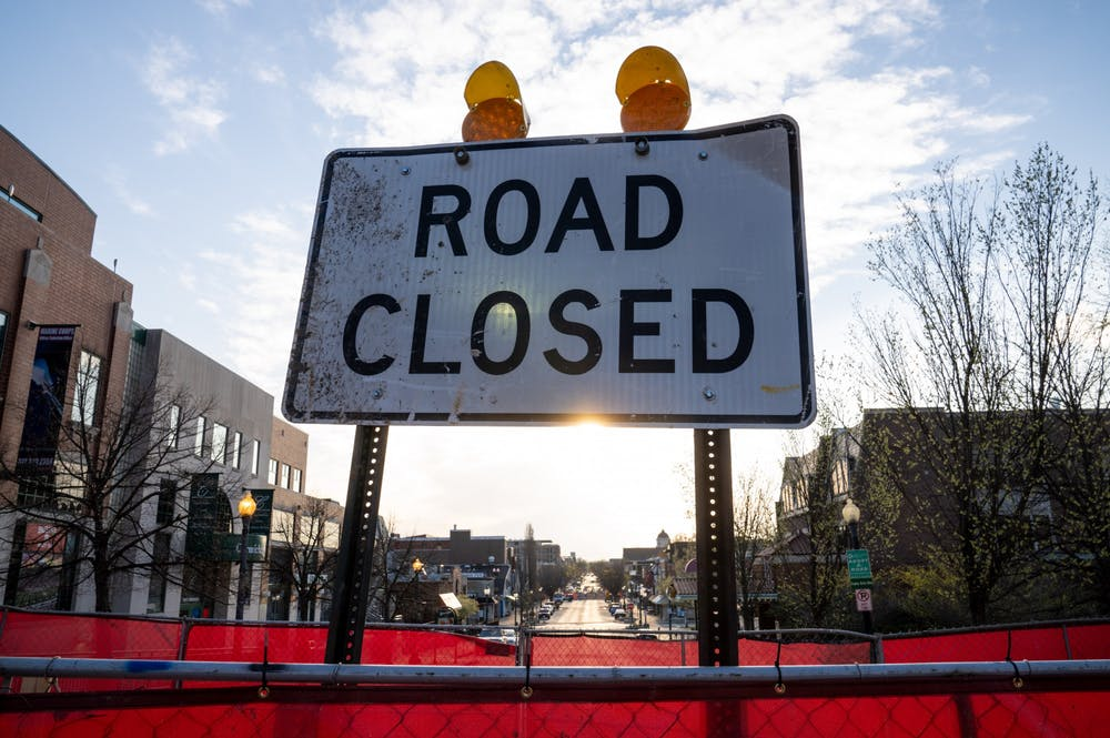 <p>A crosswalk construction sign is pictured April 8 at Kirkwood and Indiana avenues. Various road-improvement and infrastructure projects in Bloomington have started during Gov. Eric Holcomb's stay-at-home order, which is scheduled to last until April 20.</p>