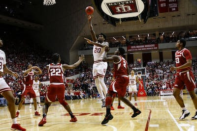 Junior forward De'Ron Davis scores the ball against University of Arkansas on March 23 at Simon Skjodt Assembly Hall. IU defeated Arkansas in the second round of the NIT, 63-60.