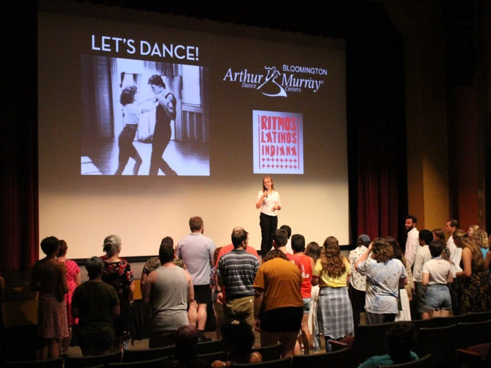 """A member of Ritmos Latinos Indiana teaches the audience salsa dancing Friday night at the Buskirk-Chumley Theater. The event was part of the """"Dance Moves and Movies"""" series."""