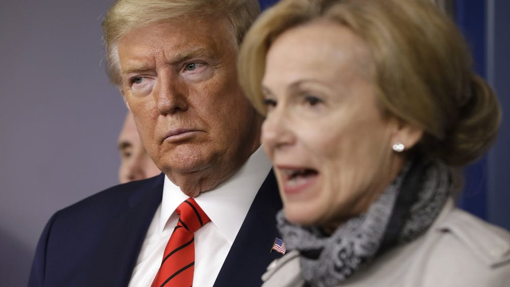 President Donald Trump listens to White House Coronavirus Response Coordinator Dr. Deborah Birx during a press briefing March 19 on the coronavirus pandemic at the White House.