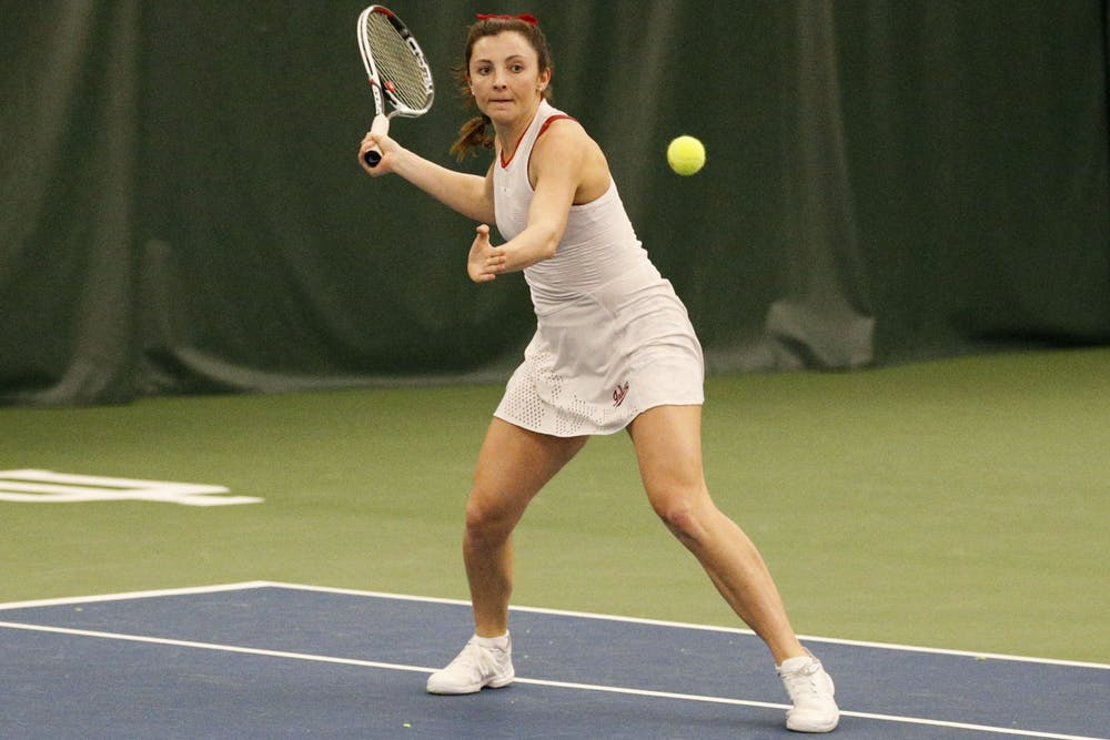<p>Senior Michelle McKamey returns a shot from her Ball State University opponents. Ball State defeated IU in all three doubles matches Feb. 23 in Bloomington. </p>
