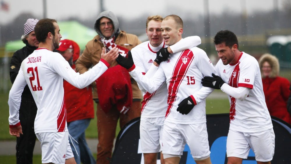 Teamates congratulate Senior Andrew Gutman after his goal Nov. 9 at Grand Park. Gutman scored the only goal during regulation time in the semifinal of the Big Ten men's soccer tournament against Maryland.