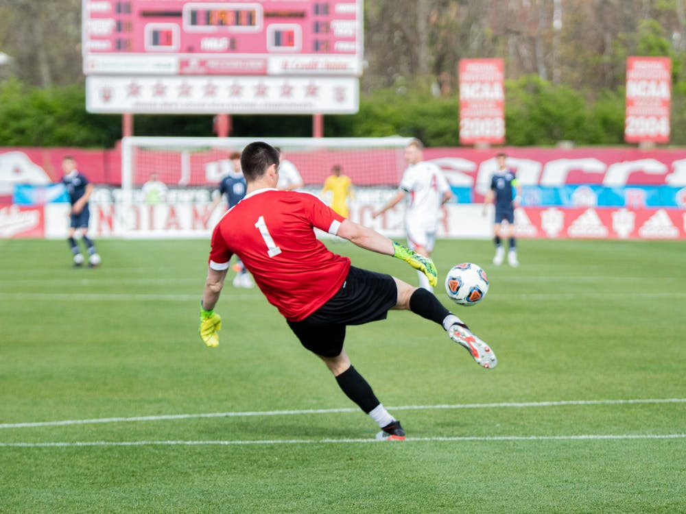 Sophomore Goalkeeper Roman Celentano kicks the ball against Penn State in the Big Ten Men's Soccer Tournament Championship on April 17 in Bill Armstrong Stadium. IU defeated the University of Pittsburgh 1-0 Friday to advance to the NCAA Championship.