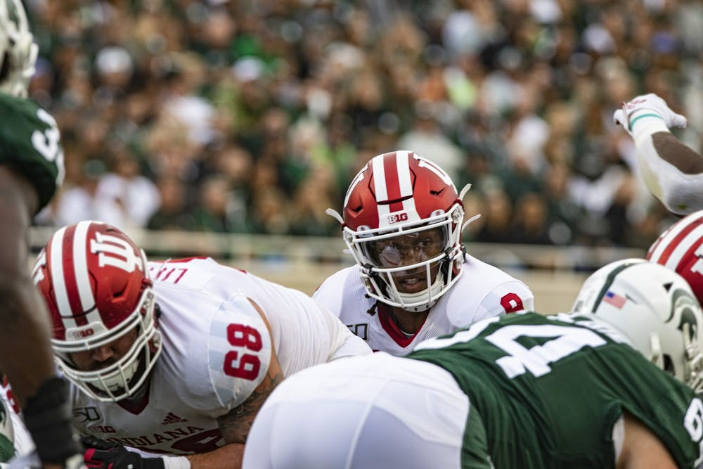 <p>Sophomore quarterback Michael Penix Jr. peers over the Michigan State defensive line Sept. 28, 2019, in Spartan Stadium in East Lansing, Michigan. IU head coach Tom Allen revealed Penix is one of the team&#x27;s captains for the 2020 season.</p>