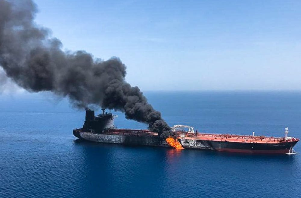 <p>Fire and smoke comes from a Norwegian owned Front Altair tanker June 13 in the waters of the Gulf of Oman. It sent world oil prices soaring as Iran helped rescue stricken crew members. </p><p></p><p></p>