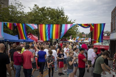 The Bloomington Pridefest attendees wander around Aug. 31 on East Kirkwood Avenue. Pridefest offered many booths with food, clothes and awareness to different organizations.