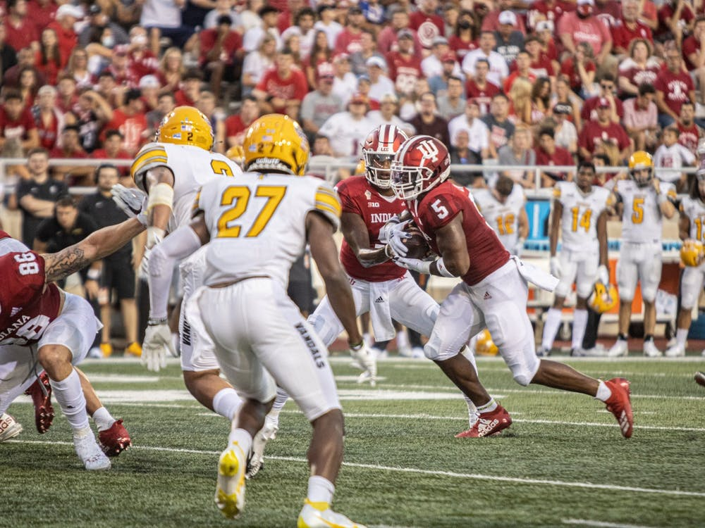 Quarterback Michael Penix Jr. hands the ball to running back Stephen Carr during the game against the University of Idaho on Sept. 11, 2021 at Memorial Stadium. Indiana beat the University of Western Kentucky Hilltoppers by a score of 33-31.