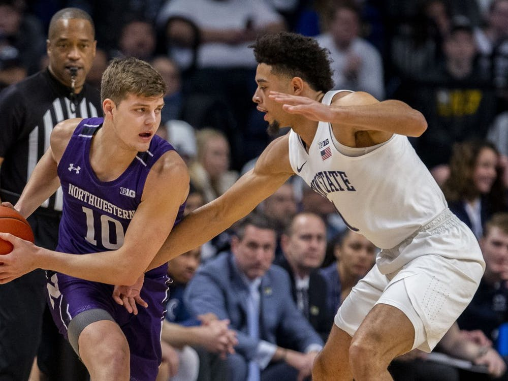 Northwestern wing Miller Kopp, number 10, is defended by Penn State wing Seth Lundy on Feb. 15, 2020, at the Bryce Jordan Center in State College, Pennsylvania. Kopp announced Tuesday he will transfer to IU.