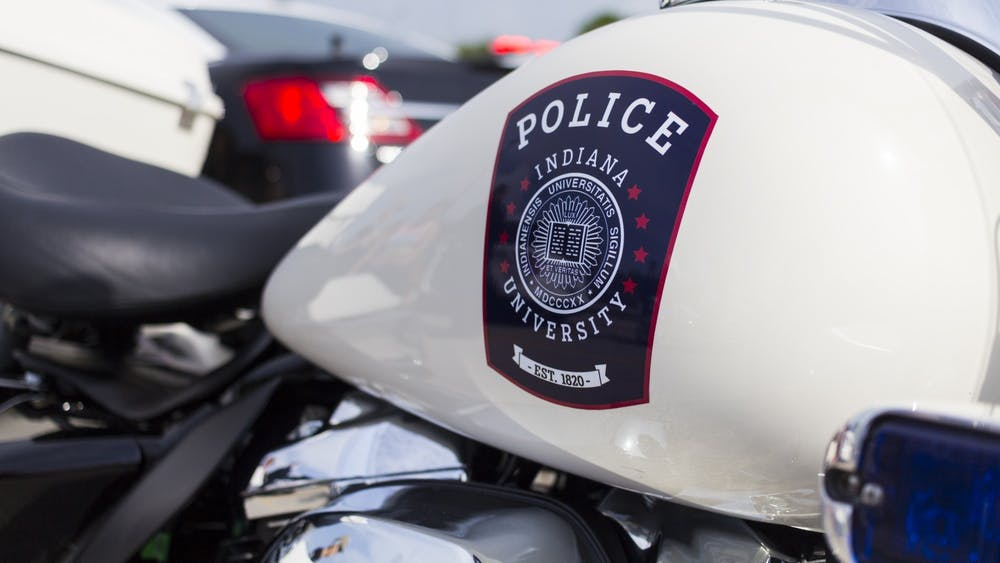"""The IU Police Department crest is displayed on an IUPD motorcycle at the """"Touch a Truck"""" event on July 2, 2018, in the Chick-fil-A parking lot on East Third Street. The IU Police Department said its policy to not include specific locations of sexual assaults on its public crime log is to protect survivors."""