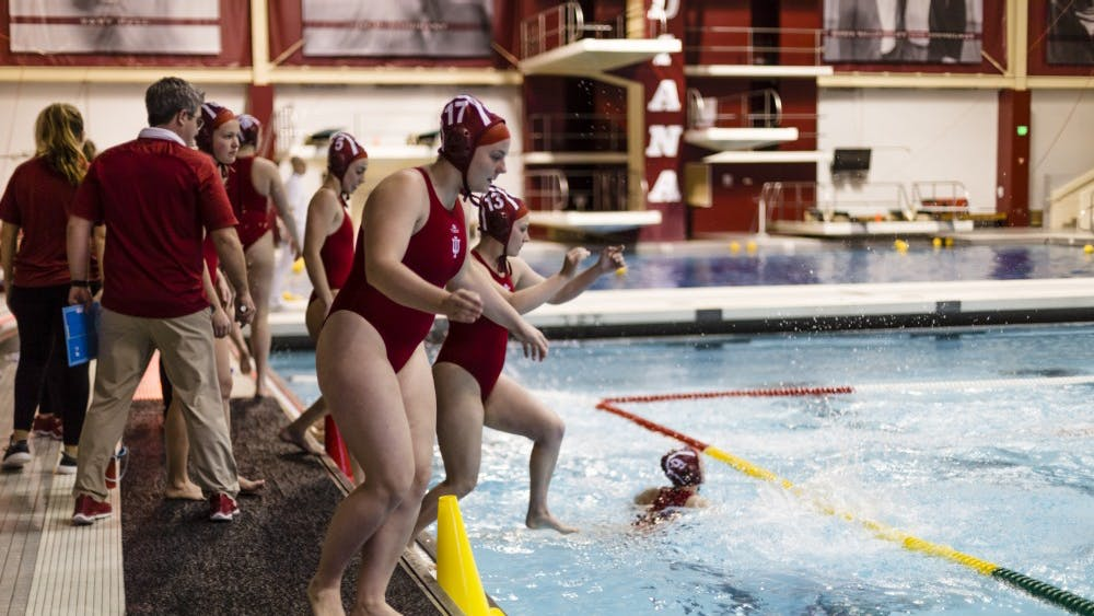 Freshman Riley Beemer leaps into the pool, preparing to face UC Santa Barbara on Jan. 29. IU won against four out of four schools during the Santa Clara invite Feb. 24 and 25.