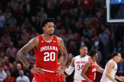 Junior forward De'Ron Davis paces the court March 14 after the Hoosiers fall behind against the Buckeyes during the Big Ten Men's Basketball Tournament in Chicago. Davis contributed nine points to IU's loss to Ohio State, 79-75.