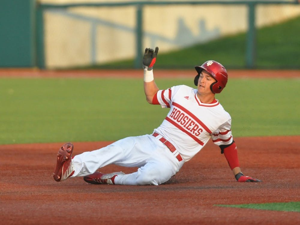 Matt Gorski slides in to second base after his double scores Indiana's fourth run of the game on Wednesday at Bart Kaufman Field. Indiana ultimately lost to Butler 7-5.