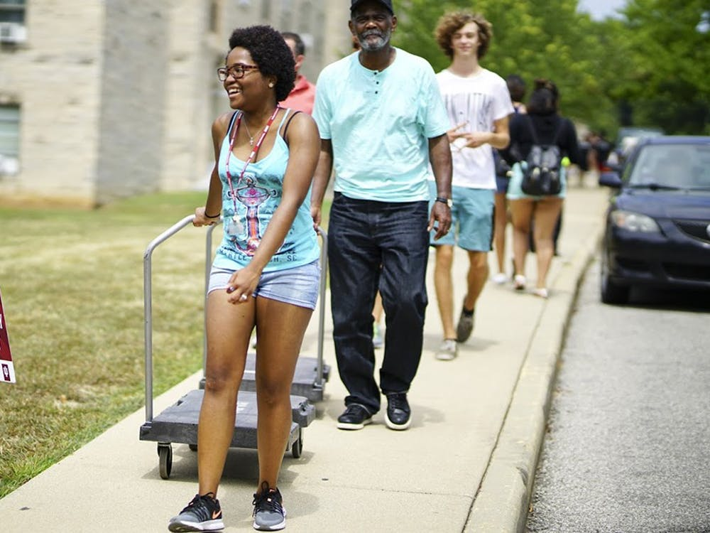 Families navigate heavy traffic and large crowds throughout IU's central neighborhood during the official move-in day and Welcome Week events in 2017.