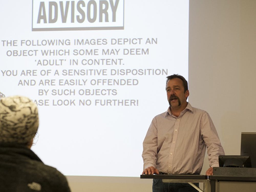 Dean Adams, a ceramic artist, gives his lecture at the Henry Radford HopeSchool of Fine Arts on Tuesday. Adams teaches at Montana State University and exhibits nationally and internationally and hisart and lecture give special attention to the male anatomy.