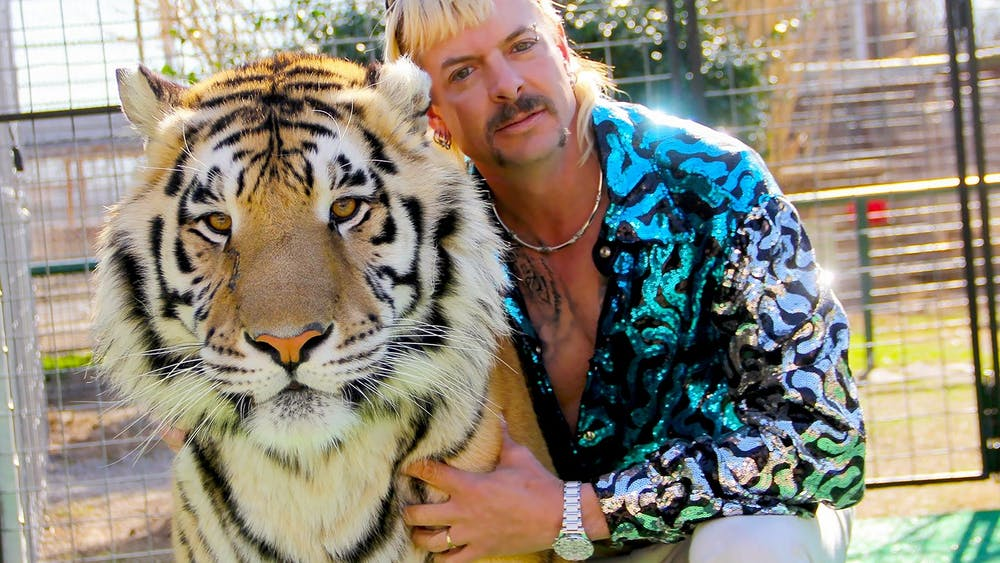 """""""Tiger King"""" star Joe Exotic poses for a photo. Timothy Stark, """"Tiger King"""" star and owner of Wildlife in Need animal sanctuary, is no longer allowed to own exotic or native animals, according to an Indiana court ruling released April 7."""