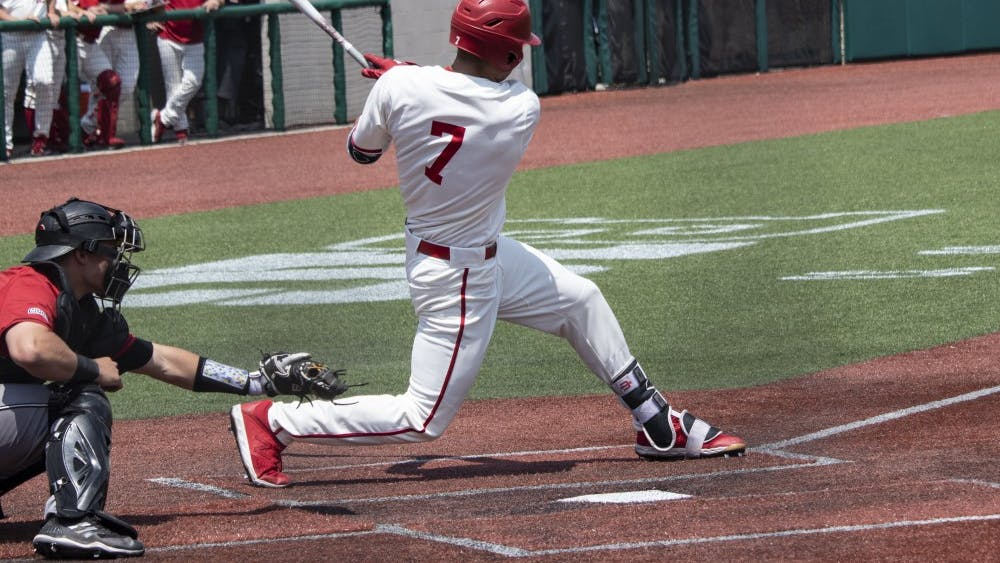 Junior outfielder Matt Gorski hits the ball May 18 at Bart Kaufman Field. Gorski was out at first base against Rutgers.
