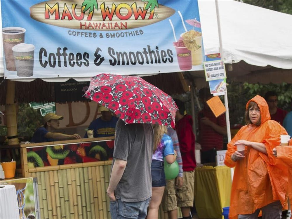 Brightly colored umbrellas and ponchos are seen keeping customers dry Saturday at the Taste of Bloomington. The annual event featured over 40 local restaurants, wineries, and breweries.