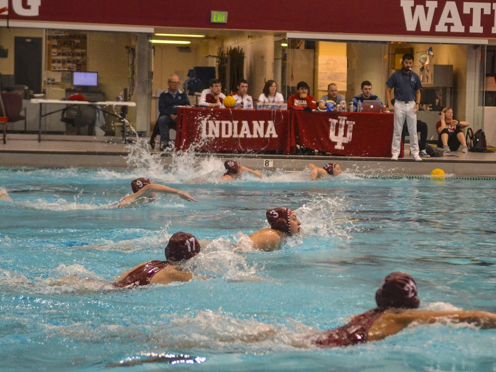 Members of the women's water polo team swim to the center of the court to start the quarter March 7, 2020, in the Counsilman-Billingsley Aquatics Center. The Hoosiers beat Saint Francis 16-2 on Saturday at the Counsilman-Billingsley Aquatics Center.