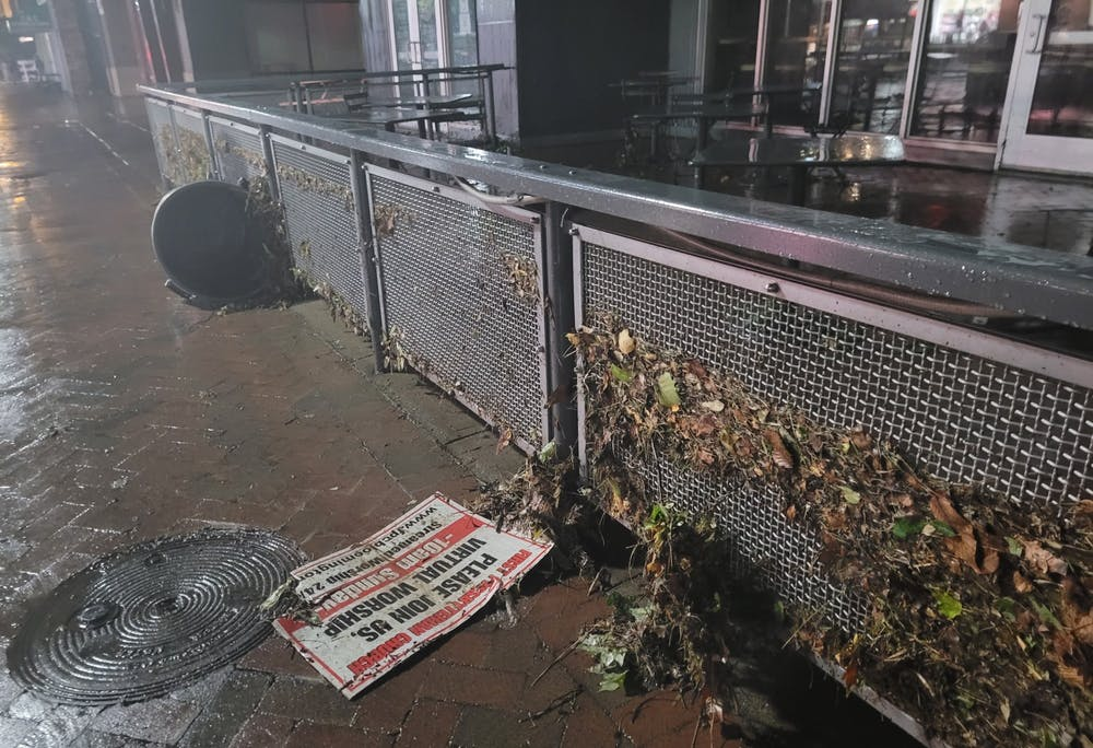 Debris cluttered outside of Chipotle on Kirkwood Avenue after Friday night's flood. Multiple Bloomington residents found themselves stuck in town during the storm.