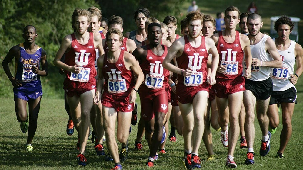 Members of the men's cross country team run up a hill during the Indiana Open on Sept. 5. Both the men's and women's teams won by large margins and allowed the runners to compete for the first time this season.