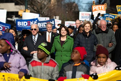 Democratic presidential candidates former Vice President Joe Biden and Sens. Amy Klobuchar, Elizabeth Warren and Bernie Sanders, march Jan. 20 to the King Day at the Dome event in Columbia, South Carolina. The New York Times' editorial board endorsed Klobuchar and Warren as the Democratic Party's presidential candidate.