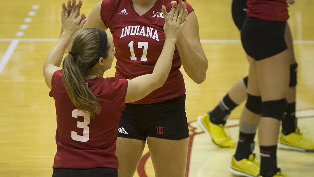 Junior Kyndall Merritt and senior Morgan Leach celebrate a successful play during the Hoosier's game vs. SEMO on Sept. 6 at Assembly Hall. IU lost Wednesday to Purdue in straight sets.