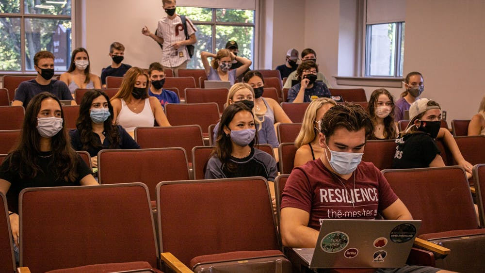 Students wait for the start of their class on Aug. 23, 2021, in Wylie Hall. As the semester progresses and COVID-19 cases fluctuate in Indiana, IU students and faculty members have expressed concerns regarding IU's current COVID-19 protocols.