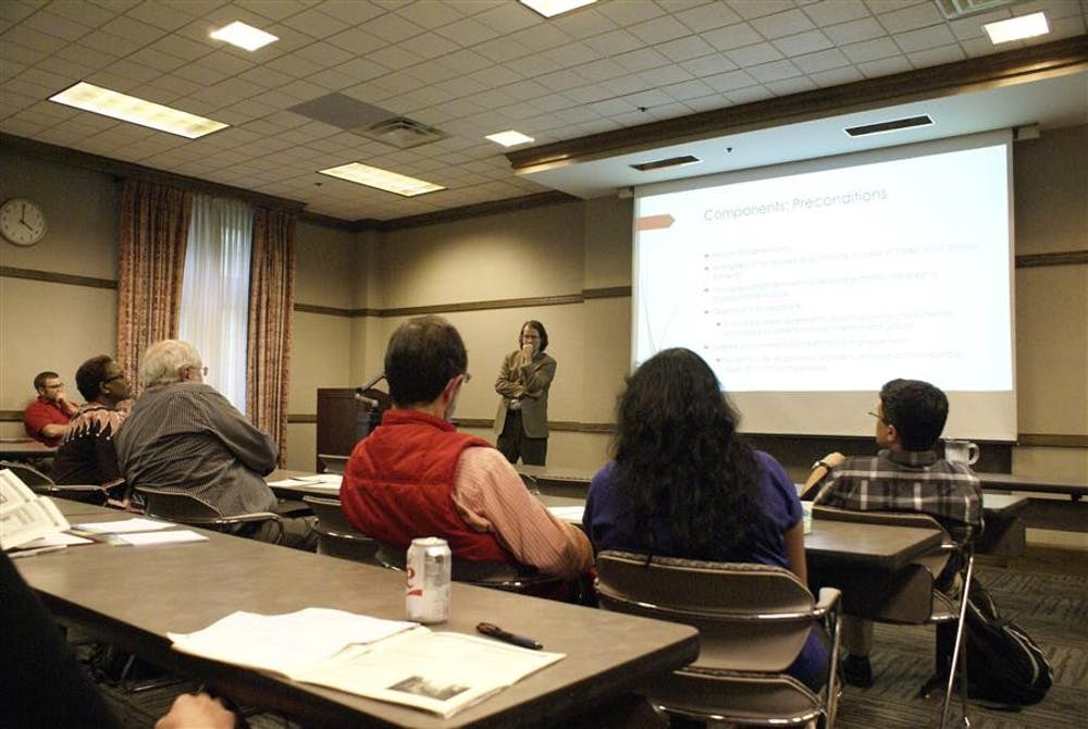 """Speaker Shane Day contemplates an audience member's question following his presentation Friday during the 5th Workshop on the Ostrom Workshop at the IMU.  Day spoke on the topic """"The Emergence of Federal-Tribal Co-Management of Protected Lands: A Prospective Research Agenda."""""""