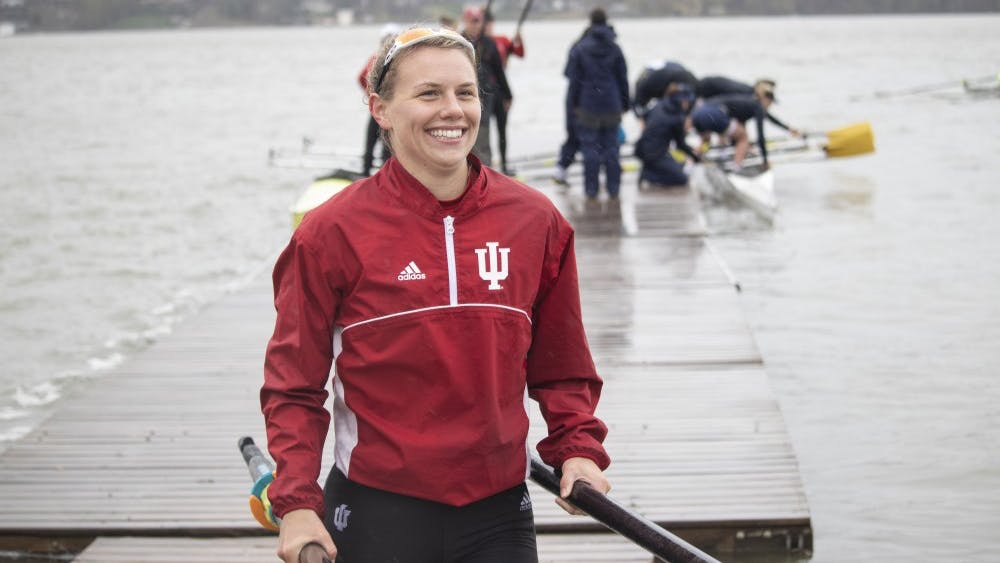 Senior varsity rower Emma Lawrie smiles after winning a race April 20 at Dale England Rowing Center on Lake Lemon. IU beat University of Notre Dame and Michigan State.