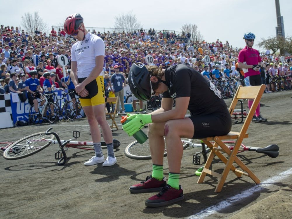 Senior Hank Duncan of Forest Cycling sits Saturday during a moment of silence before the 2019 men's Little 500 at Bill Armstrong Stadium. Forest finished 13th.
