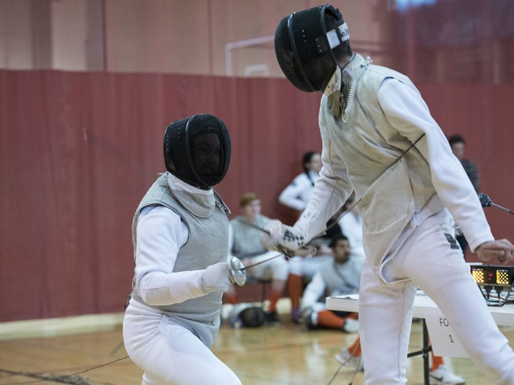 Junior Micheal Zelenka competes second in the foil match against Illinois. Men's foil fencing lost 4-5 to Illinois.
