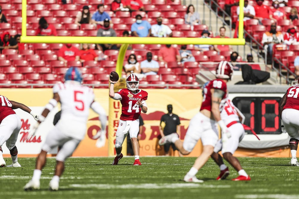 <p>Redshirt sophomore quarterback Jack Tuttle makes a pass Jan. 2 at Raymond James Stadium in Tampa, Florida. Indiana ended the 2020-21 season with a 6-2 record. </p>