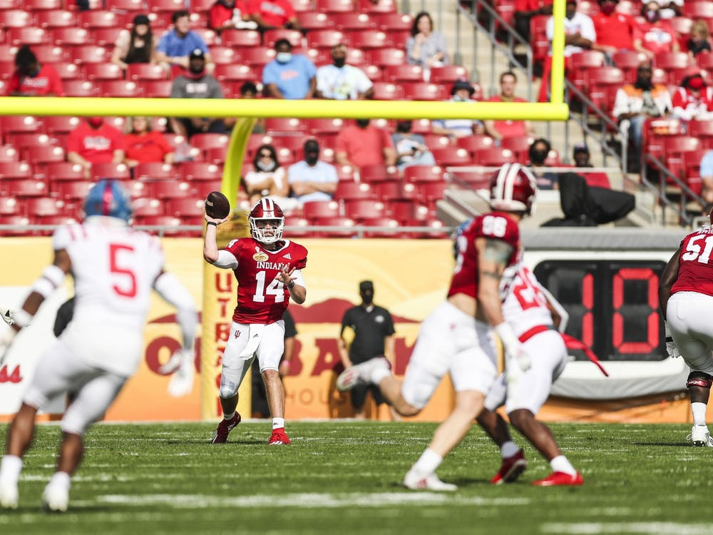 Redshirt sophomore quarterback Jack Tuttle makes a pass Jan. 2 at Raymond James Stadium in Tampa, Florida. Indiana ended the 2020-21 season with a 6-2 record.