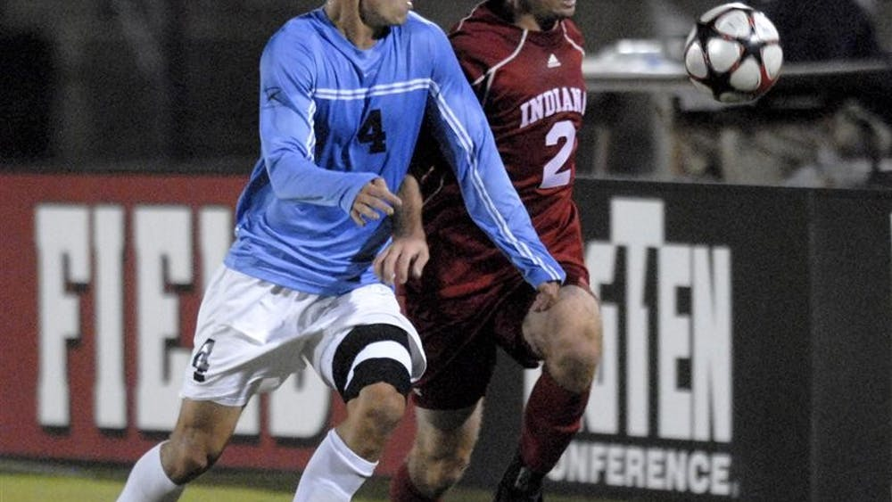 Junior midfielder Rich Balchan eyes the ball with Butler's Brett Heinz near the end of the first half Wednesday at Bill Armstrong Stadium. Though the Hoosiers scored in the fourth minute, the Bulldogs sunk a late goal and scored in the last minutes of the second overtime to bring IU to a 5-4-1 record.