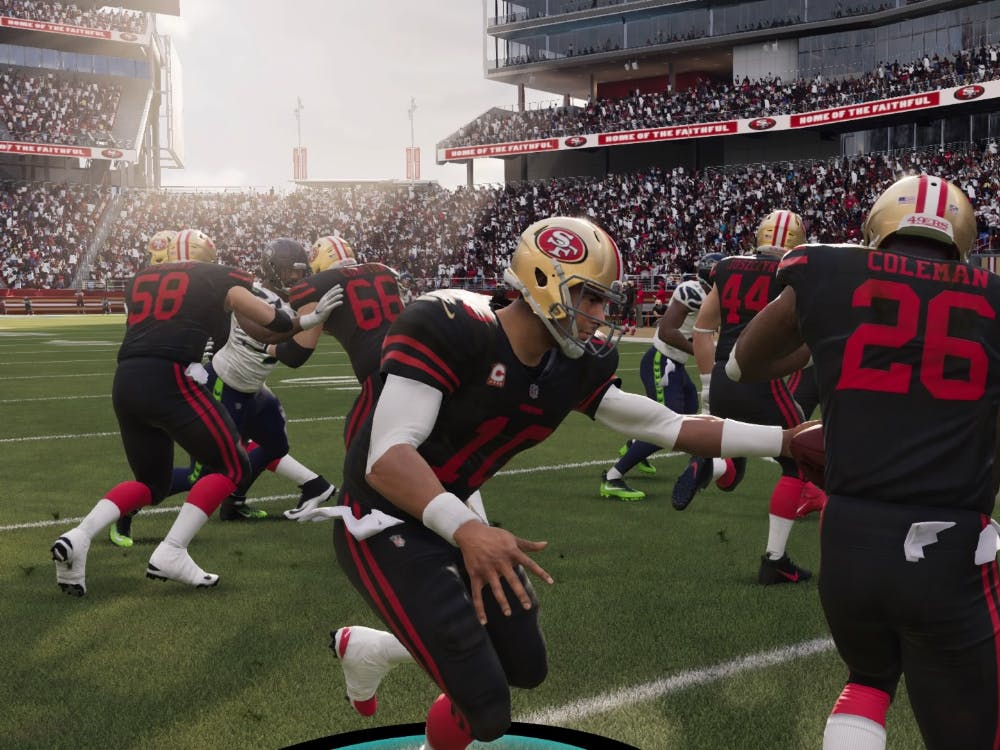 Former IU running back Tevin Coleman receives a handoff from San Francisco 49ers quarterback Jimmy Garoppolo in the video game Madden 21.