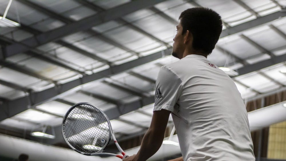 Sophomore Brandon Lam prepares to return a serve April 14 at the IU Tennis Center. IU defeated Saint Louis University, 7-0.
