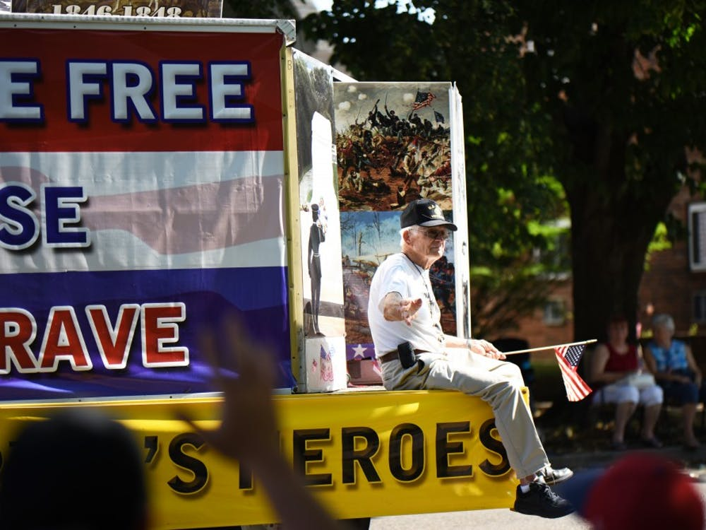 On a float celebrating war heroes, veterans sit on each side and wave to the crowd. The float along with many others traveled from the sample gates and around the courthouse during the 4th of July parade Tuesday.